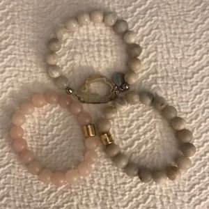 Three bracelets in muted pastels